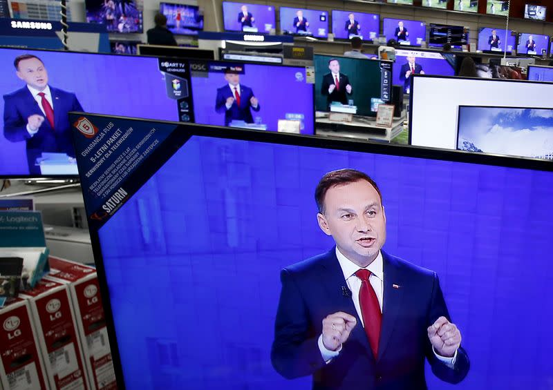 FILE PHOTO: Andrzej Duda is seen on television screens at a shopping mall in Warsaw