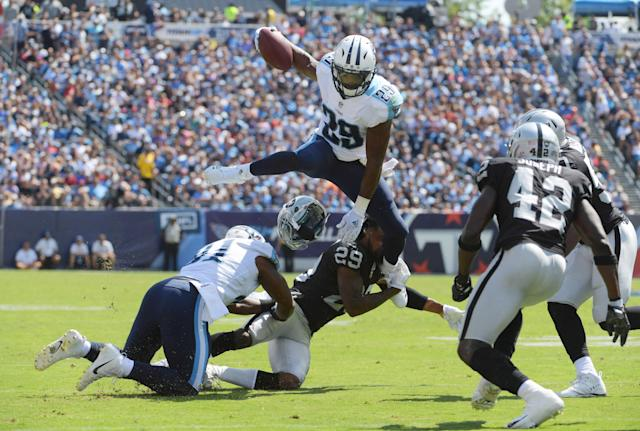 <p>Tennessee Titans running back DeMarco Murray (top) leaps over Oakland Raiders cornerback David Amerson (bottom) during a NFL football game at Nissan Stadium. The Raiders defeated the Titans 26-16. Mandatory Credit: Kirby Lee-USA TODAY Sports </p>