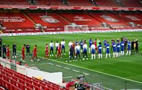 Liverpool players walking through a guard of honour from Chelsea players prior to their Premier League match. (PHOTO: Darren Walsh/Chelsea FC via Getty Images)