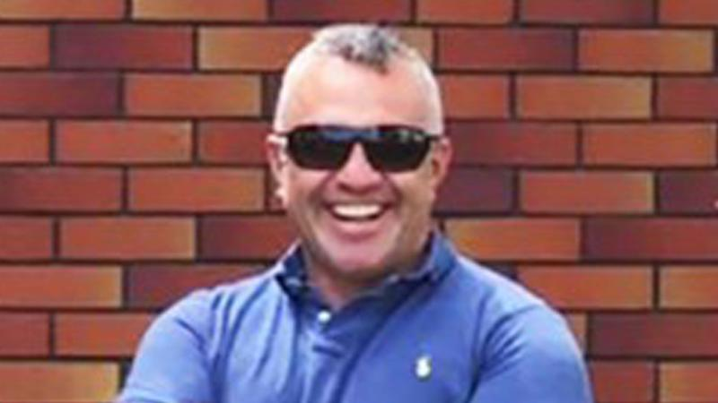 Silent tributes for 'truly remarkable' police officer and rugby coach