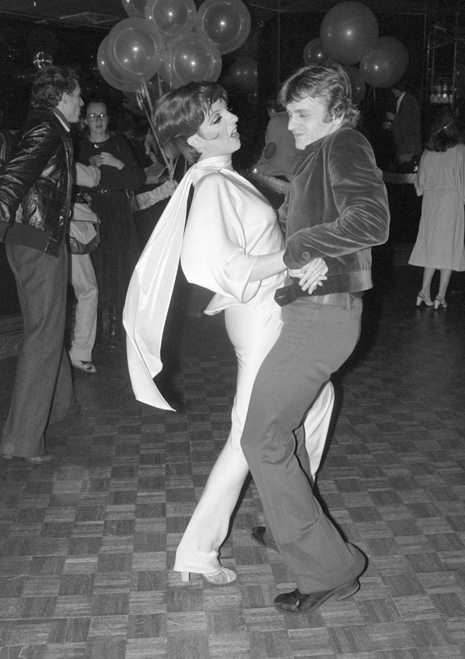 <p>Liza Minnelli and ballet dancer Mikhail Baryshnikov dance together at Studio 54 in 1977.</p>