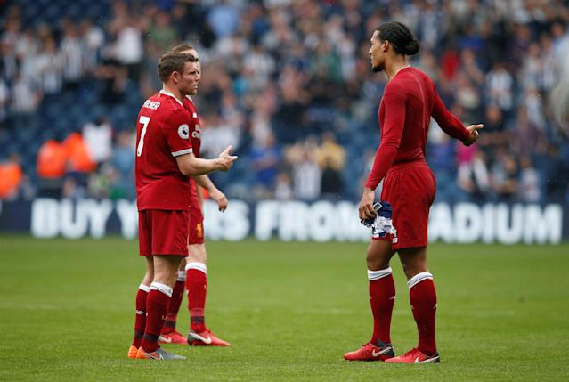 """Soccer Football - Premier League - West Bromwich Albion v Liverpool - The Hawthorns, West Bromwich, Britain - April 21, 2018 Liverpool's James Milner and Virgil van Dijk look dejected after the match REUTERS/Andrew Yates EDITORIAL USE ONLY. No use with unauthorized audio, video, data, fixture lists, club/league logos or """"live"""" services. Online in-match use limited to 75 images, no video emulation. No use in betting, games or single club/league/player publications. Please contact your account representative for further details."""