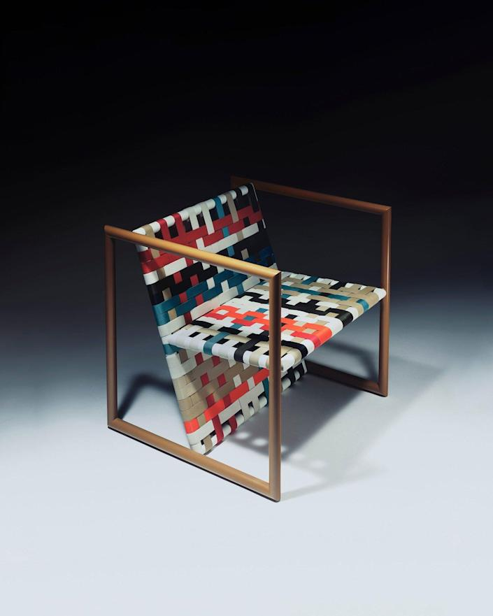 A colorful marquetry-inspired chair featured inJonathan Saunders' debut furniture collection.