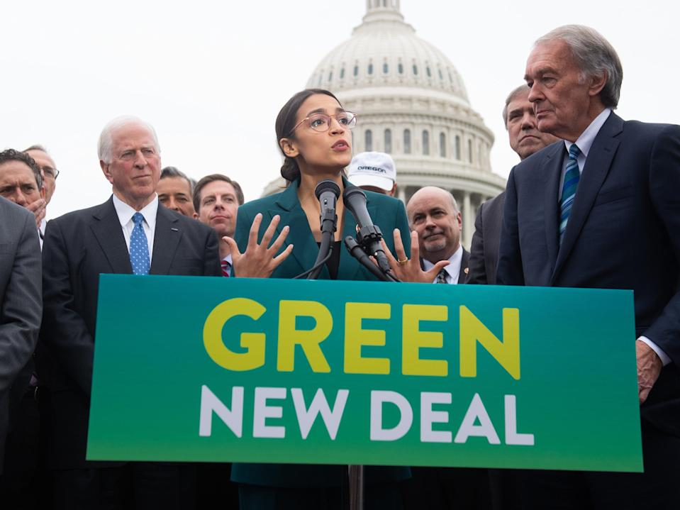 Alexandria Ocasio-Cortez and Ed Markey introduce the Green New Deal resolution on 7 February 2019 (AFP via Getty Images)