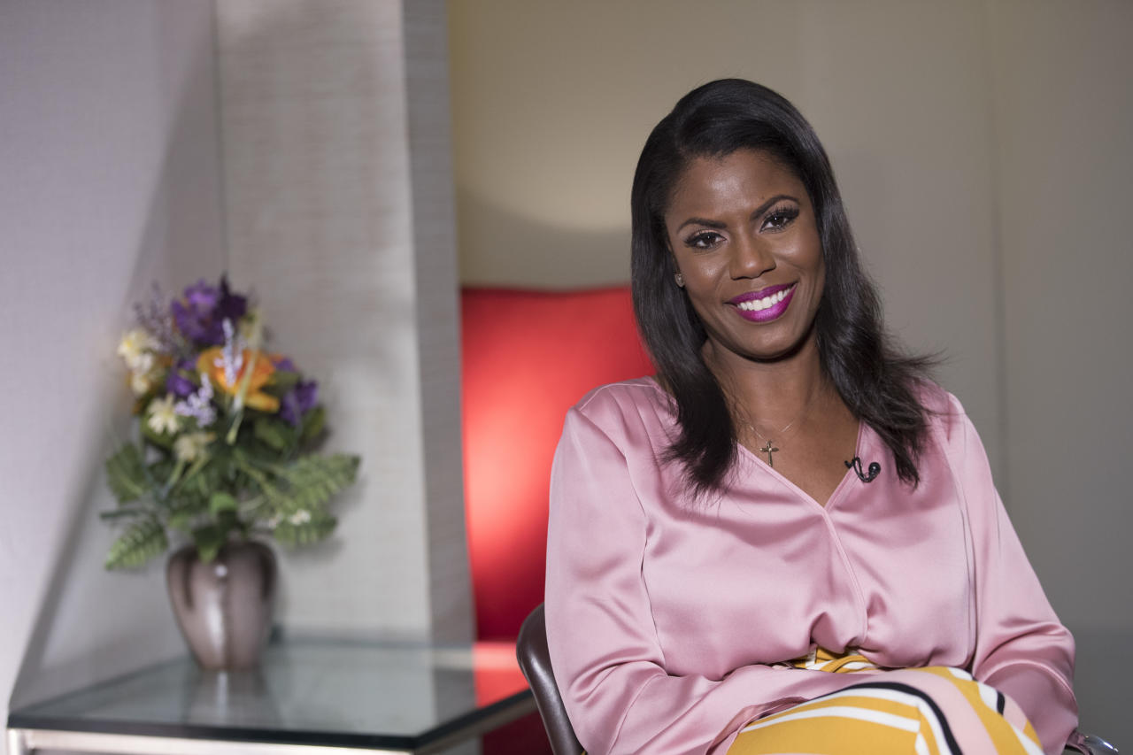 Television personality and former White House staffer Omarosa Manigault Newman smiles during an interview with The Associated Press, Tuesday, Aug. 14, 2018, in New York. (AP Photo/Mary Altaffer)