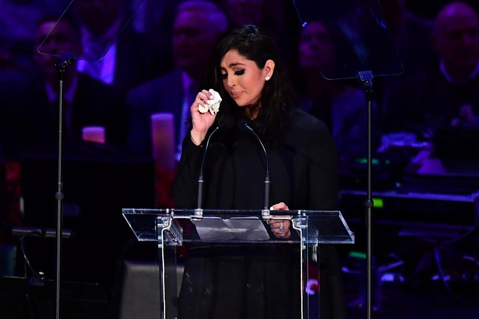 TOPSHOT - Kobe Bryant's wife Vanessa Bryant wipes away tears as she speaks during the