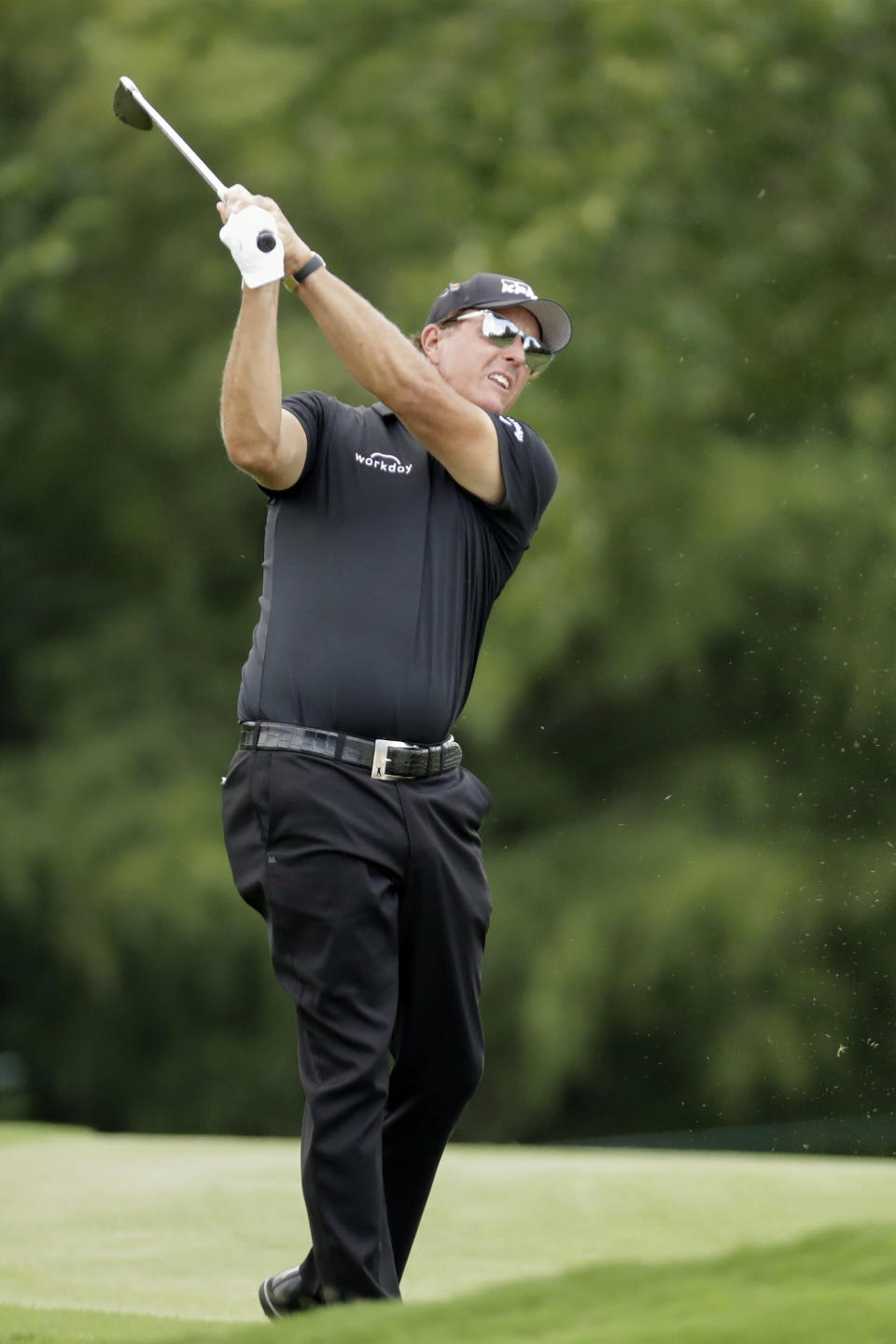 Phil Mickelson hits form the fairway on the first hole during the final round of the World Golf Championship-FedEx St. Jude Invitational Sunday, Aug. 2, 2020, in Memphis, Tenn. (AP Photo/Mark Humphrey)