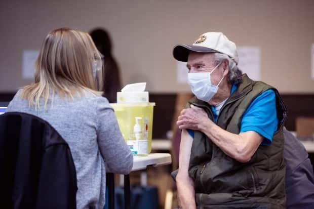 Alberta set a new pace for its vaccine rollout Thursday, administering almost 64,000 doses. The province expanded eligibility this week to everyone over 12.  (Alberta Health Services - image credit)