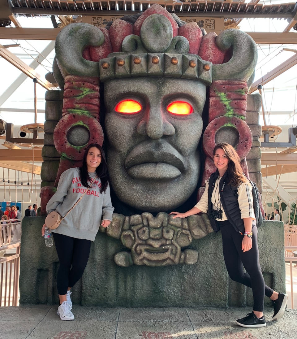 "We waited to get our photo opp with Olmec, a prop from 90s Nickelodeon hit ""Legends of the Hidden Temple"" at Nickelodeon Universe. (Photo: Stephanie Asymkos/Yahoo Finance)"