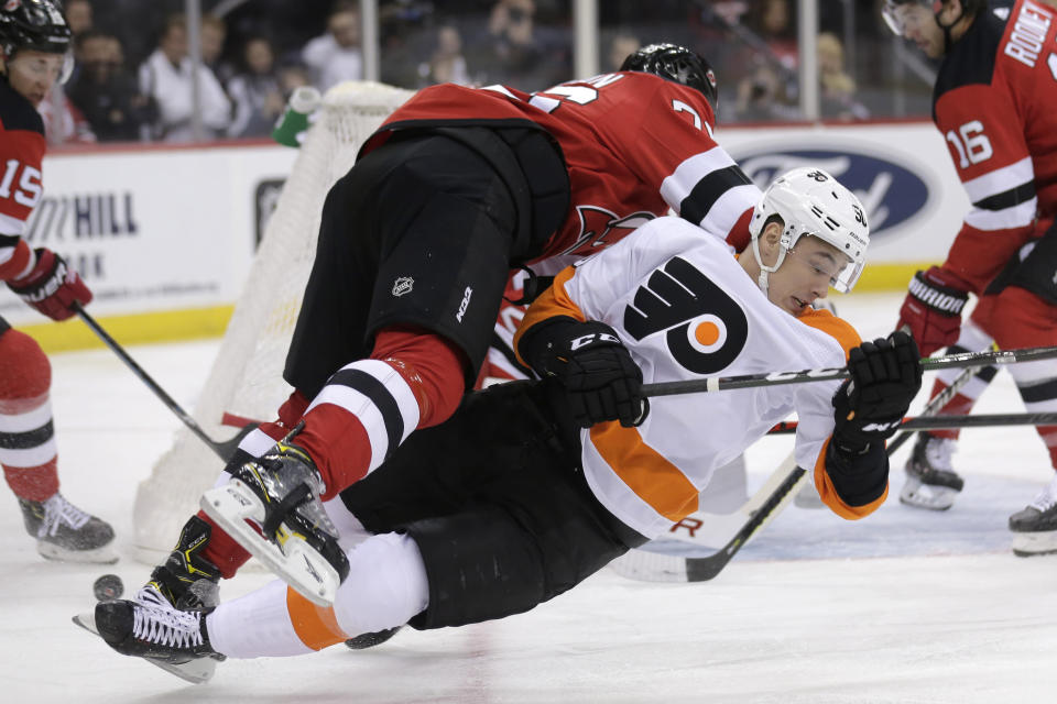 Philadelphia Flyers' German Rubtsov, right, becomes entangled with New Jersey Devils' P.K. Subban during the first period of an NHL hockey game in Newark, N.J., Friday, Nov. 1, 2019. (AP Photo/Seth Wenig)