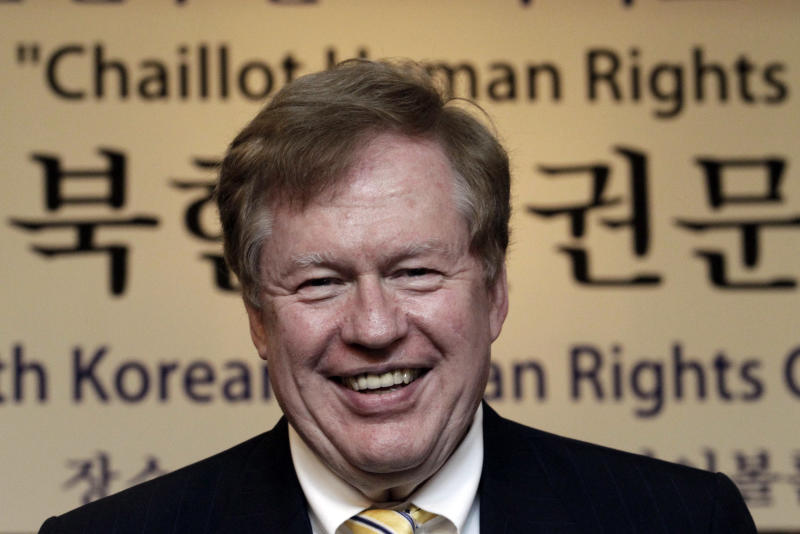 """U.S. special envoy for North Korean human rights issues, Robert King, talks with participants during the Korea Institute for National Unification's International Conference on North Korean Human Rights in Seoul, South Korea, Thursday, June 14, 2012. The letters at a banner read """" North Korean Human Rights.""""  (AP Photo/Ahn Young-joon)"""