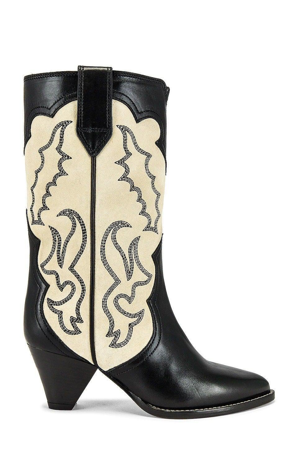 """<br><br><strong>Isabel Marant</strong> Linle Bootie, $, available at <a href=""""https://www.revolve.com/isabel-marant-linle-bootie/dp/IMAR-WZ112/?d=Womens&page=1&lc=15&itrownum=4&itcurrpage=1&itview=05"""" rel=""""nofollow noopener"""" target=""""_blank"""" data-ylk=""""slk:Revolve"""" class=""""link rapid-noclick-resp"""">Revolve</a>"""