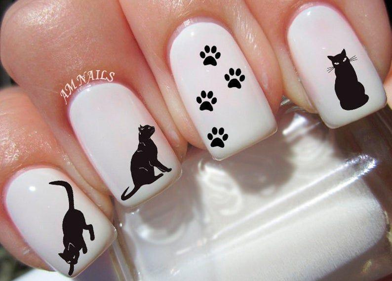 """<p><strong>AMnails</strong></p><p>etsy.com</p><p><strong>$4.99</strong></p><p><a href=""""https://go.redirectingat.com?id=74968X1596630&url=https%3A%2F%2Fwww.etsy.com%2Flisting%2F240797552%2F48-black-cat-nail-decals&sref=https%3A%2F%2Fwww.oprahdaily.com%2Fbeauty%2Fskin-makeup%2Fg33239588%2Fhalloween-nail-ideas%2F"""" rel=""""nofollow noopener"""" target=""""_blank"""" data-ylk=""""slk:SHOP NOW"""" class=""""link rapid-noclick-resp"""">SHOP NOW</a></p><p>Looking for a manicure that's both cute and creepy? These black cat nail decals are purrfect.</p>"""