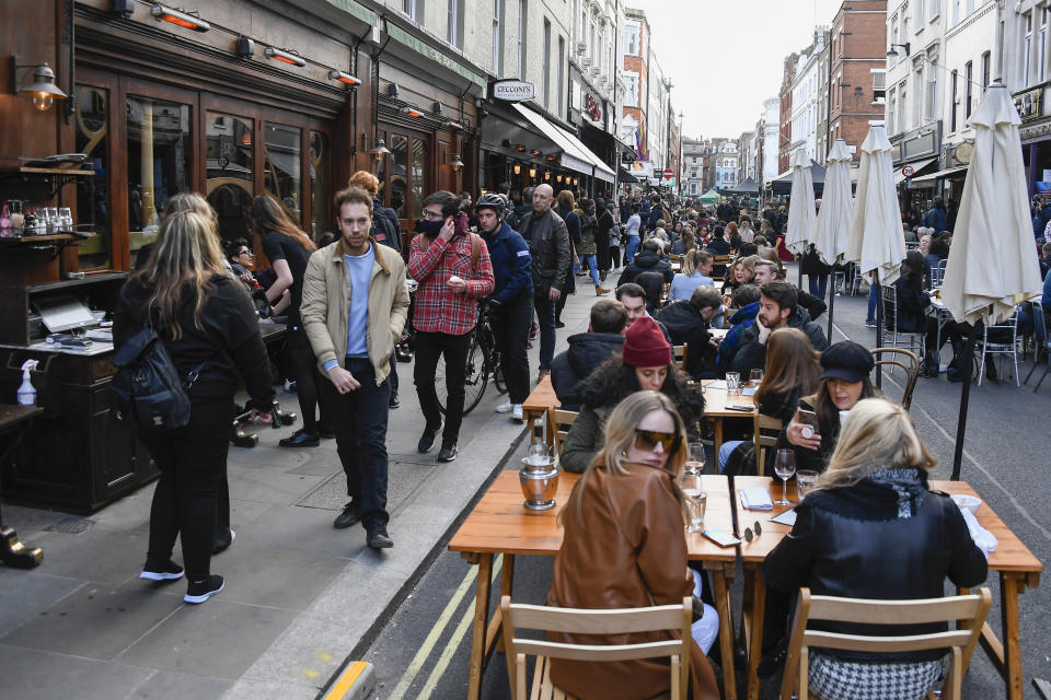 People outside pubs and restaurants in Soho, London, on the day some of England's coronavirus lockdown restrictions were eased on 12 April. Photo: AP Photo/Alberto Pezzali