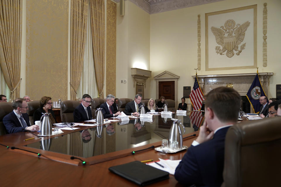The Federal Reserve Board, including chair Jerome Powell, fourth from left, holds a meeting to discuss proposed rules to modify the enhanced prudential standard framework for large banking organizations, Wednesday, Oct. 31, 2018, at the Marriner S. Eccles Federal Reserve Board Building in Washington. (AP Photo/Jacquelyn Martin)
