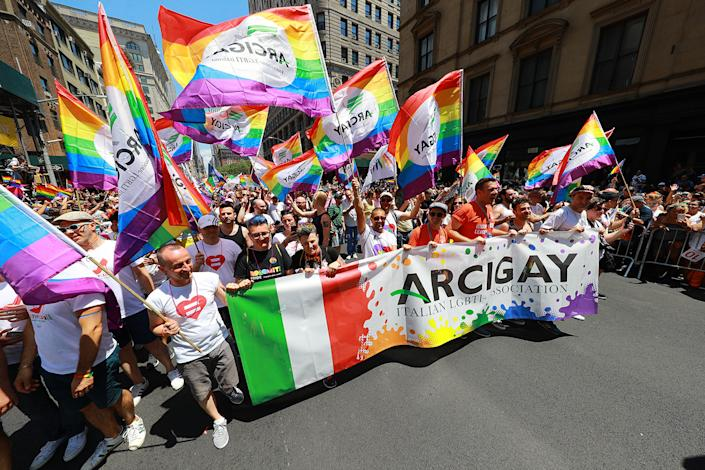 The Italian LGBTI Association carry a banner and wave flags  during the NYC Pride Parade in New York, Sunday, June 30, 2019. (Gordon Donovan/Yahoo News)