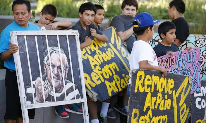 People protest against former sheriff Joe Arpaio in front of the Maricopa county sheriff's office in Phoenix, 25 May 2016.