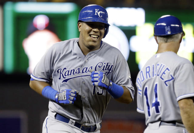Kansas City Royals' Salvador Perez smiles as he passes third base coach Eddie Rodriguez following his two-run home run off Minnesota Twins pitcher Casey Fien in the eighth inning of a baseball game, Wednesday, Aug. 28, 2013 in Minneapolis. Perez went 4-for-5 with four RBIs, including another two-run home run in the fourth inning. The Royals won 8-1. (AP Photo/Jim Mone)