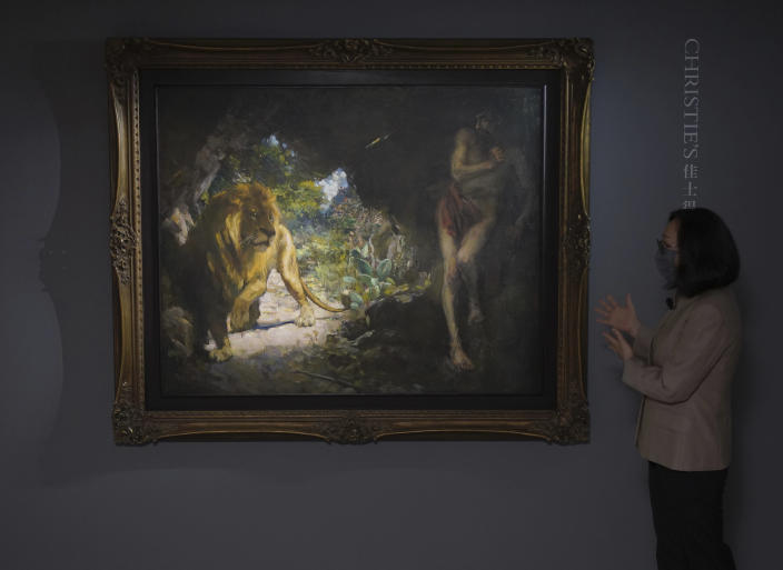 """A painting by Chinese modern artist Xu Beihong, titled """"Slave and Lion."""" is displayed during a Christie's auction preview in Hong Kong, Monday, April 19, 2021. The painting by Xu from 1924 is expected to fetch at least $45 million in an auction in Hong Kong, as the appetite for art continues to rise among collectors even amid global economic uncertainty brought about by the coronavirus pandemic. (AP Photo/Vincent Yu)"""