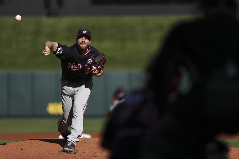 Washington Nationals starting pitcher Max Scherzer throws during the first inning of Game 2 of the baseball National League Championship Series against the St. Louis Cardinals Saturday, Oct. 12, 2019, in St. Louis. (AP Photo/Jamie Squire, Pool)