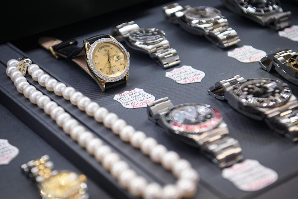 A diamond-encrusted Rolex watch is seen in a store window in the financial district, also known as the Square Mile, on January 20, 2017 in London, England. Photo by Leon Neal/Getty Images