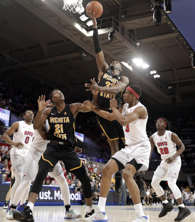 Wichita State forward Markis McDuffie (32) goes up for a shot over forward Darral Willis Jr. (21) and Southern Methodist guard William Douglas (3) in the first half of an NCAA college basketball game Saturday, Feb. 24, 2018, in Dallas. (AP Photo/Tony Gutierrez)