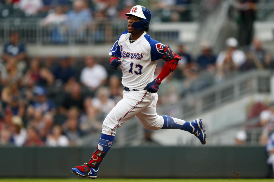Atlanta Braves' Ronald Acuna Jr. runs to second base after hitting a double in the first inning of the team's baseball game against the Cincinnati Reds on Thursday, Aug. 1, 2019, in Atlanta. (AP Photo/John Bazemore)