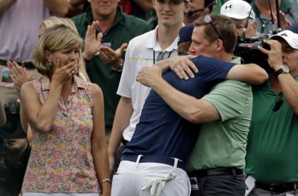 Chris Spieth, left, watches as Jordan Spieth hugs his father Shawn after winning the Masters. (AP)