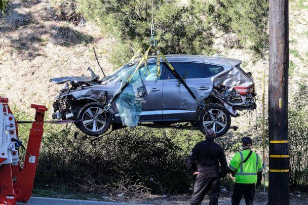 PHOTO: A crane is used to lift the vehicle involving golfer Tiger Woods, Feb. 23, 2021, in the Rancho Palos Verdes suburb of Los Angeles. (Ringo H.W. Chiu/AP)