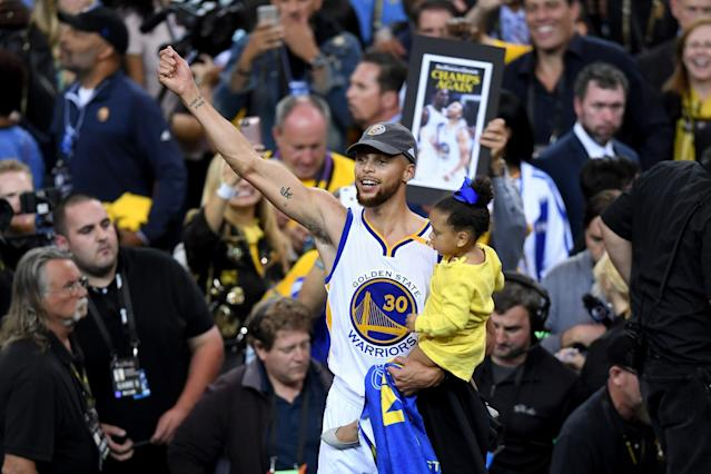 <p>Stephen Curry #30 of the Golden State Warriors celebrates holding his daughter Ryan after defeating the Cleveland Cavaliers 129-120 in Game 5 to win the 2017 NBA Finals at ORACLE Arena on June 12, 2017 in Oakland, California. </p>