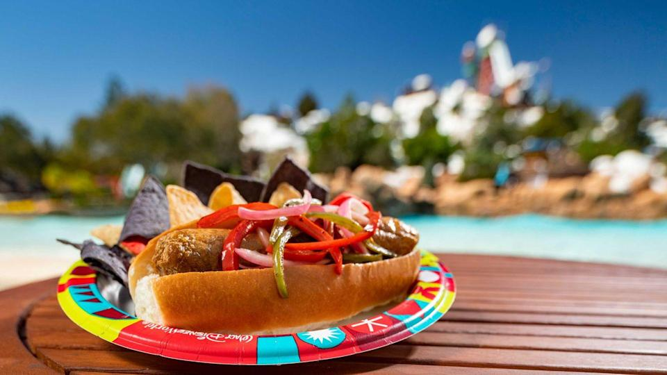 <p>The Lottawatta Lodge at Blizzard Beach mixes things up with their plant-based Bratwurst. Served with homemade chips, we didn't expect to find this meal while at Disney but we're so glad we did. </p>