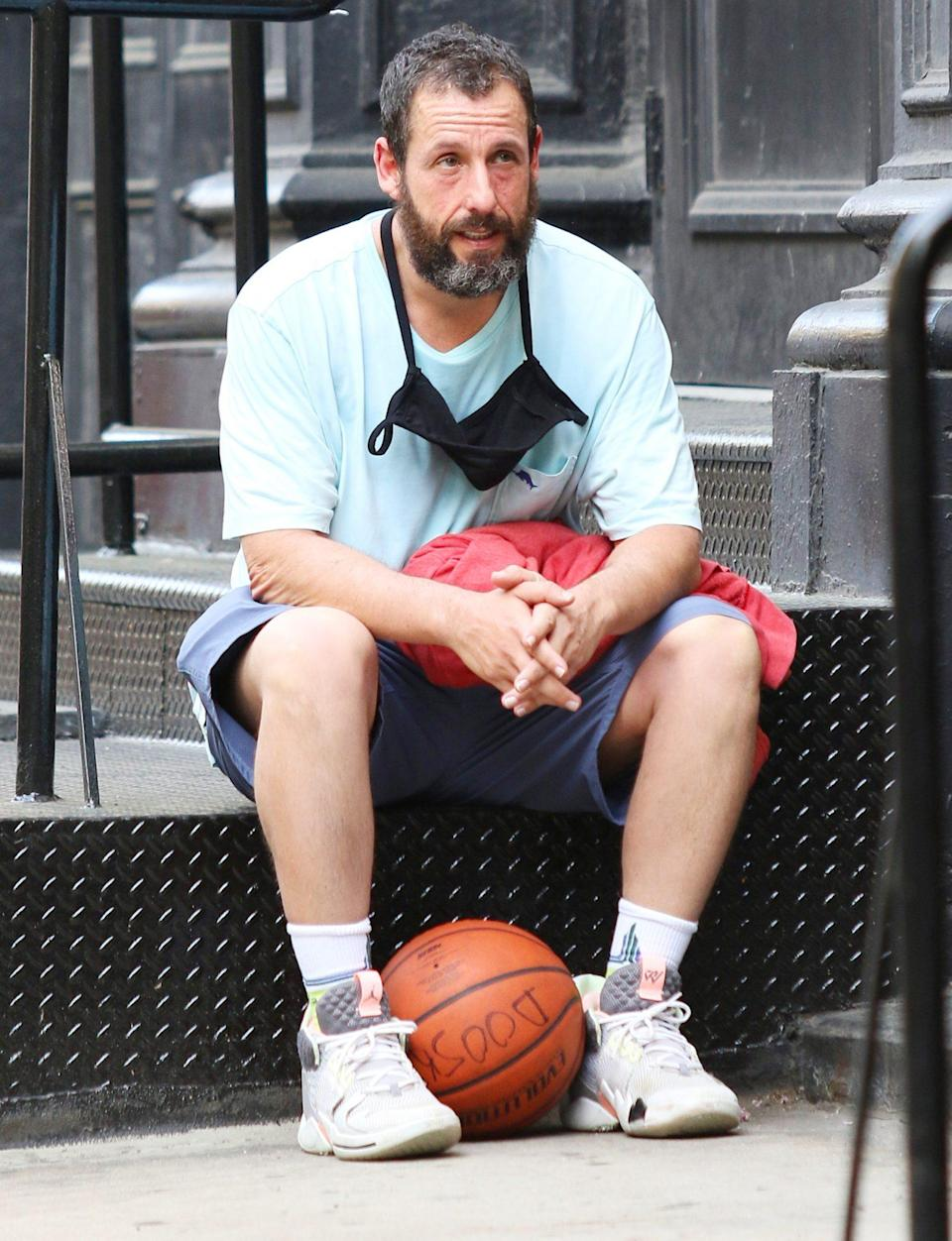 <p>Adam Sandler takes a breather after playing basketball in downtown N.Y.C. on Sunday.</p>