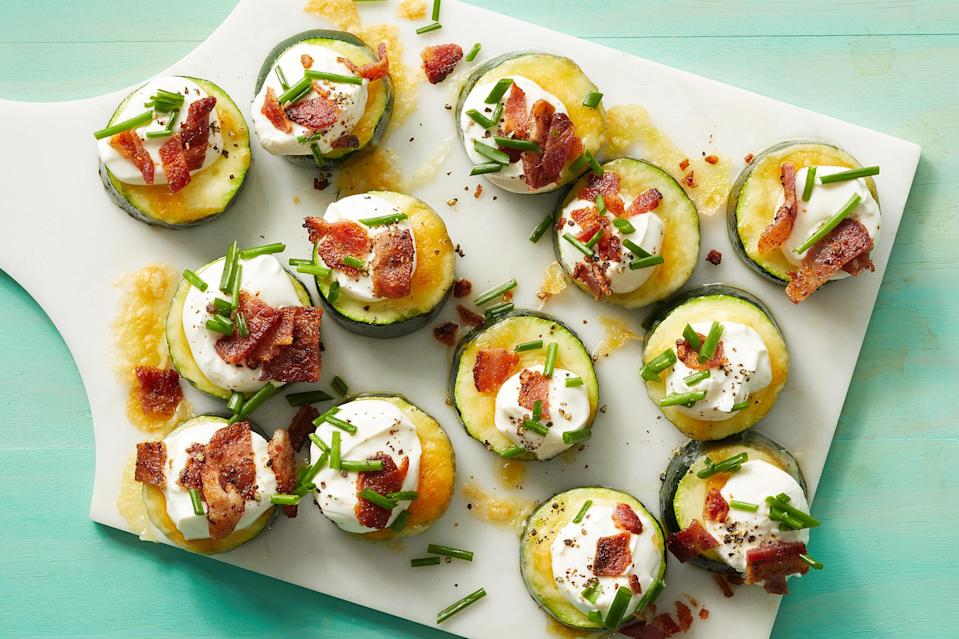 <p>These low-carb zucchini bites have all the toppings of a loaded baked potato, without the potato! Melted cheese, bacon, chives and a dollop of sour cream make these bites perfect for game day or anytime you're craving comfort food.</p>