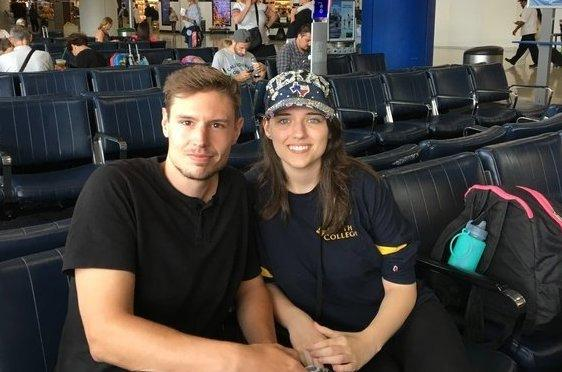 Robert Heise, 28, and Zana Shaw, 21, wait at Newark Liberty International Airport Thursday for their flight to Houston for their wedding.