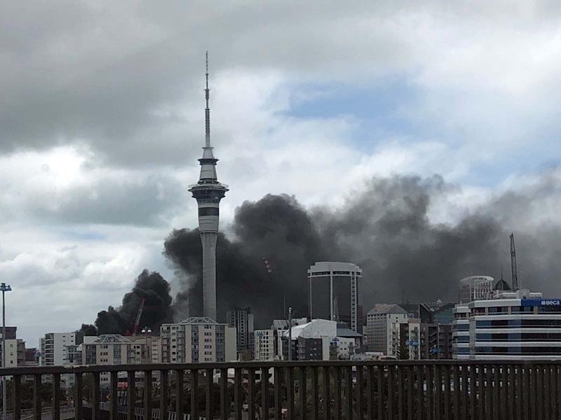 Thick smoke blows from a construction site at the convention centre: AFP via Getty Images