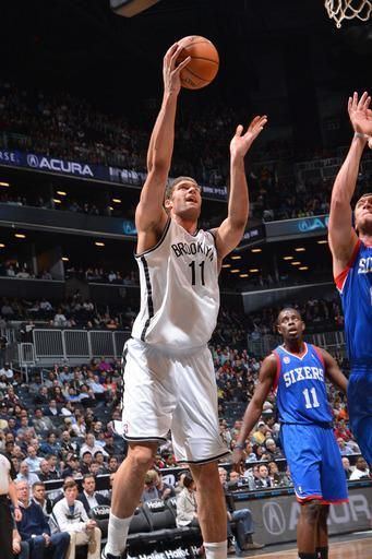 BROOKLYN, NY - APRIL 9: Brook Lopez #11 of the Brooklyn Nets shoots a layup against Spencer Hawes #00 of the Philadelphia 76ers on April 9, 2013 at the Barclays Center in Brooklyn, New York. (Photo by Jesse D. Garrabrant/NBAE via Getty Images)