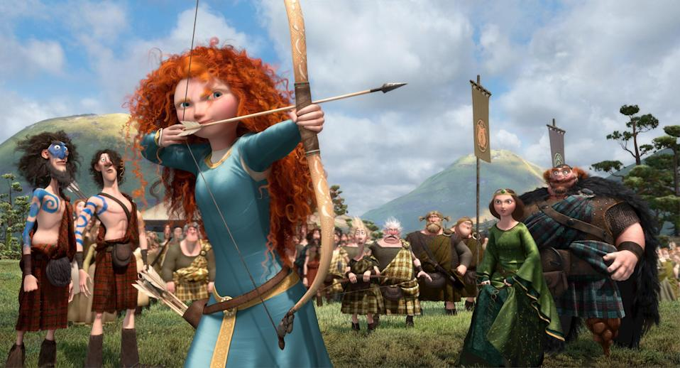 """Princess Merida is kind of a mix between <em>The Little Mermaid</em>'s Princess Ariel and <a href=""""https://www.glamour.com/story/hunger-games-mockingjay-part-two-trailer?mbid=synd_yahoo_rss"""" rel=""""nofollow noopener"""" target=""""_blank"""" data-ylk=""""slk:The Hunger Games"""" class=""""link rapid-noclick-resp""""><em>The Hunger Games</em></a>' Katniss Everdeen, in the best way possible. With Ariel's bright red hair, Katniss' archery skills, and both characters' inspiring independence, Merida defies tradition by refusing to get engaged. This causes chaos—including her mother accidentally turning into a bear (just go with it)—but the hero is able to carve her own path."""
