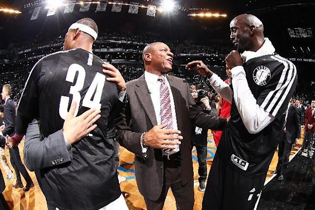 NEW YORK, NY - DECEMBER 12: Head Coach Doc Rivers of the Los Angeles Clippers talks with his former Boston Celtics players Kevin Garnett #2 of the Brooklyn Nets and Paul Pierce #34 of the Brooklyn Nets after a game at Barclays Center on December 12, 2013 in the Brooklyn borough of New York City. (Photo by Nathaniel S. Butler/NBAE via Getty Images)