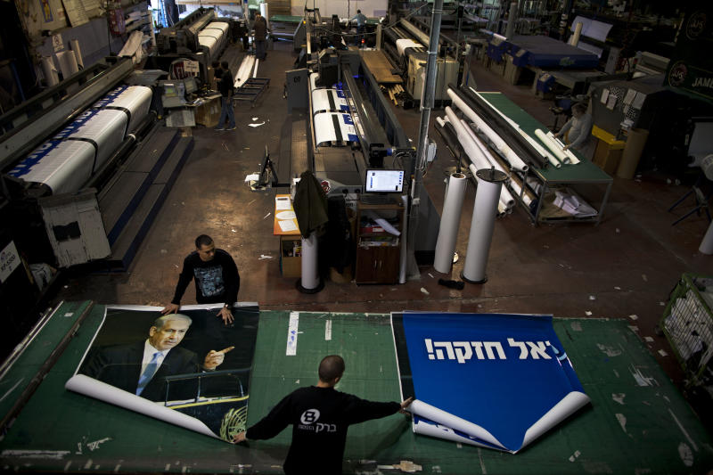 "In this photograph made on Sunday, Jan. 13, 2013, a print house employes work on an election campaign billboard of Israeli Prime Minister and Likud Party leader Benjamin Netanyahu, in the central Israeli Town of Petah Tikva. Palestinian officials largely view Benjamin Netanyahu's expected re-election with despair, fearing the Israeli hardliner's ambitious plans for settlement construction over the next four years could prove lethal to their dreams of a state. Hebrew on billboards reads - "" I need you for strong Israel"". (AP Photo/Oded Balilty)"