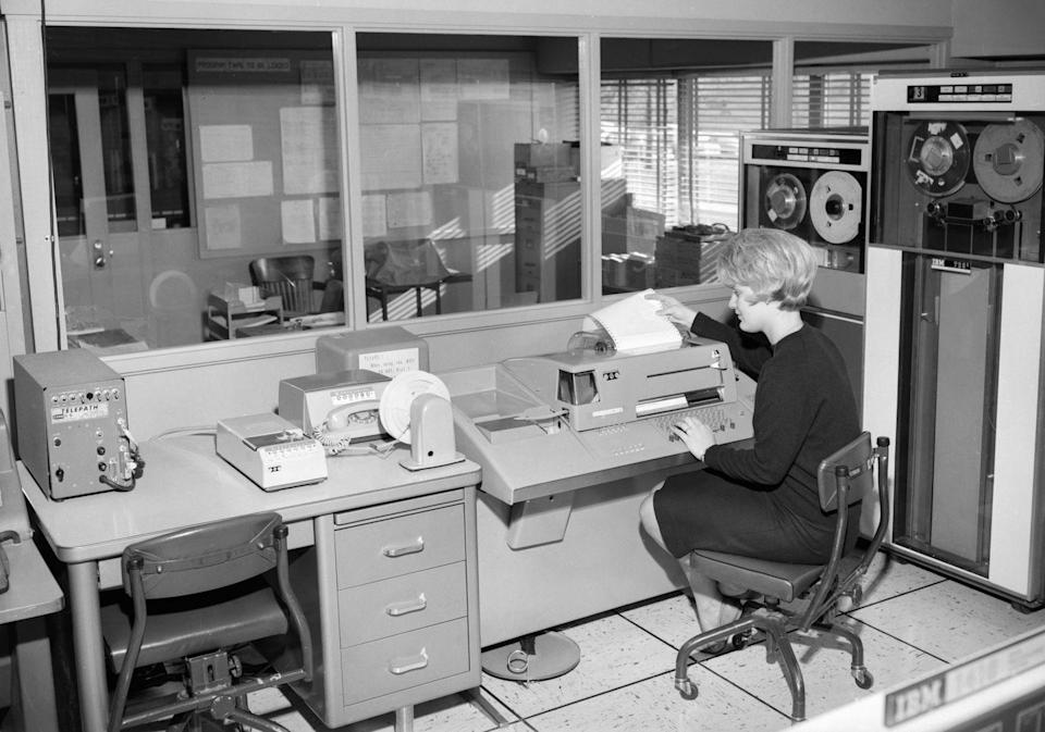 <p>IBM's technology for data storage was the industry standard at that time. The earliest IBM tape drives, such as the IBM 729II computer tape storage system pictured on the right, were mechanically sophisticated drives that allowed for the tape to start and stop quickly. The woman is working on a teletype machine, an early computer terminal that was used to transfer typed information through an electrical communications channel.</p>
