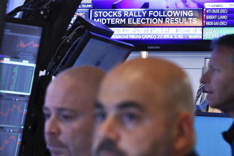 FILE - In this Nov. 7, 2018, file photo traders work in a booth on the floor of the New York Stock Exchange. A potentially tumultuous presidential election campaign promises to add some extra drama to financial markets this year, although if history is any guide investors can cast aside some worries. (AP Photo/Richard Drew, File)