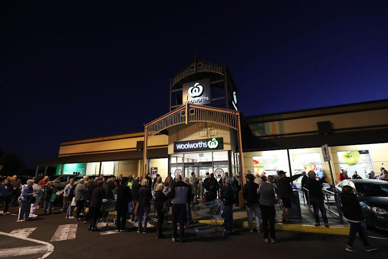 General view outside a Woolworths in Sunbury as people wait outside in Australia.
