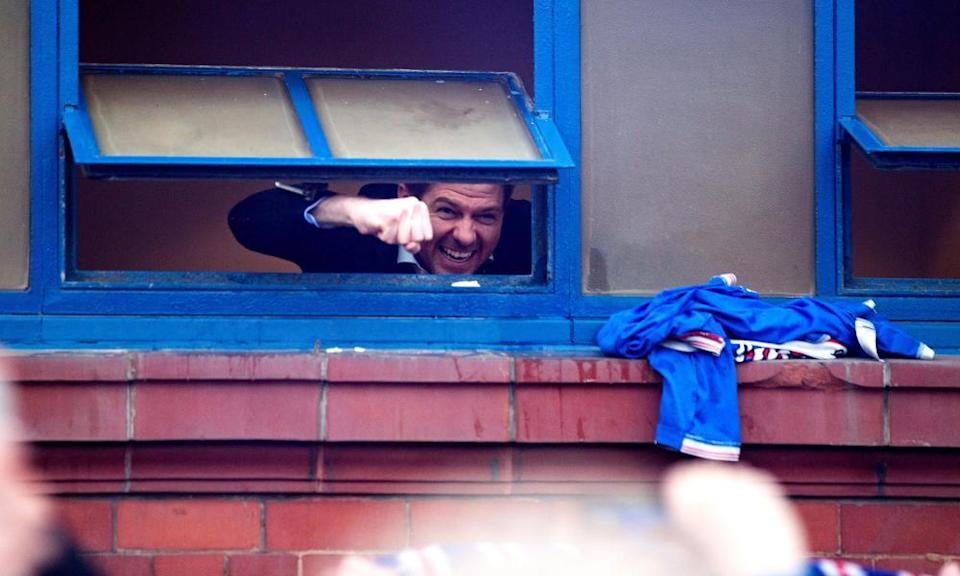 Steven Gerrard celebrates Rangers' title triumph in March with fans gathered outside Ibrox.