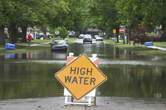 FILE - In this June 26, 2021, file photo, a sign warns of high water on a flooded Interstate 75 at 7 Mile Road in Detroit. The Federal Emergency Management Agency has approved about $29 million in grants for Detroit residents whose homes and property suffered damage from heavy flooding during a late June storm. (Max Ortiz/Detroit News via AP, File)