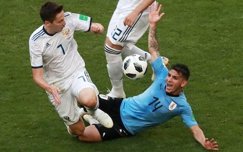 Russia's Daler Kuzyayev (L) and Uruguay's Lucas Torreira in action in their 2018 FIFA World Cup Group A football match at Samara Arena Stadium. Sergei Fadeichev - Credit: Getty Images