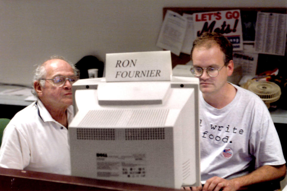 Associated Press journalists Ron Fournier, right, and Harry Rosenthal work on election night in Washington, November 2000. (AP Photo)