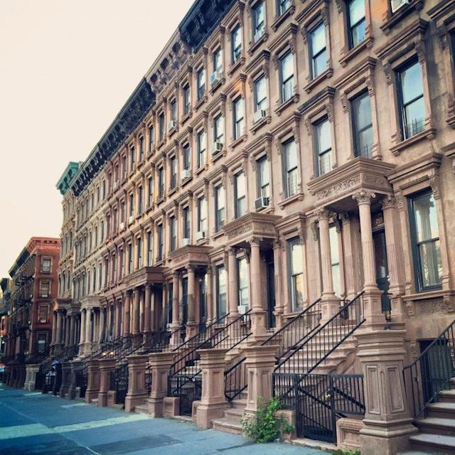 Historic brownstones on Lenox Avenue in Harlem, New York.