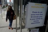 People arrive at the Javits Center mass vaccination location in New York