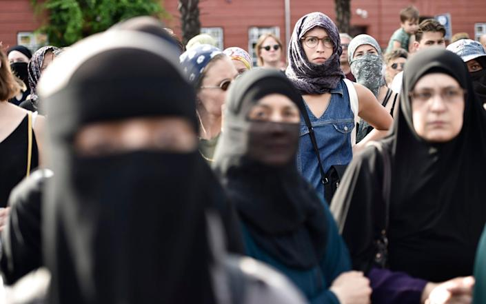 Women wearing niqab and headscarves take part in a demonstration on August 1, 2018, the first day of the implementation of the Danish face veil ban, in Copenhagen,