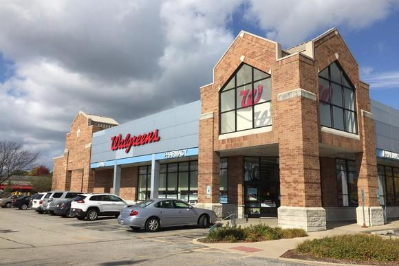 Walgreens store with cars parked in front